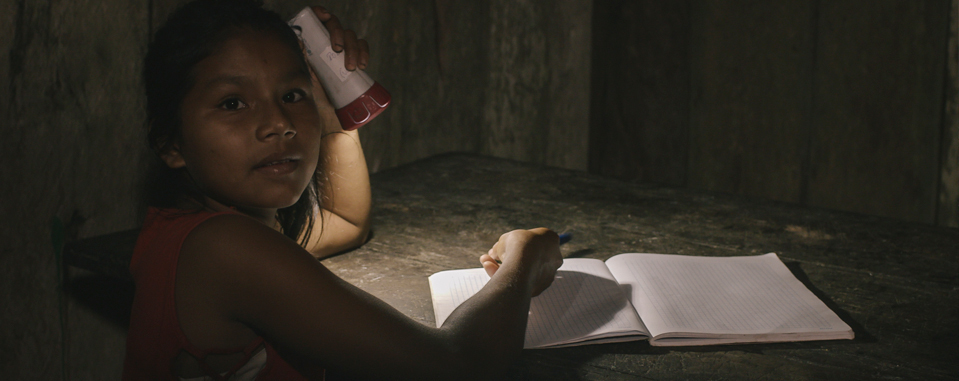 Girl doing her homework with Light at Home